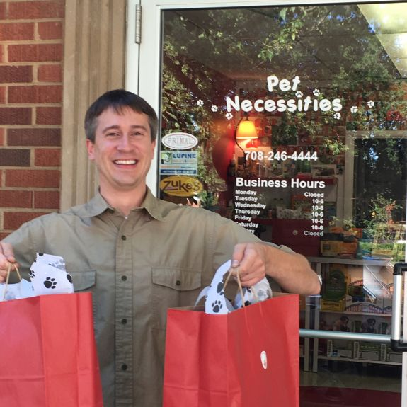 Andrew from Pet Necessities, with awesome goodies for Team Tripawds. Photo: Christine Castellano.